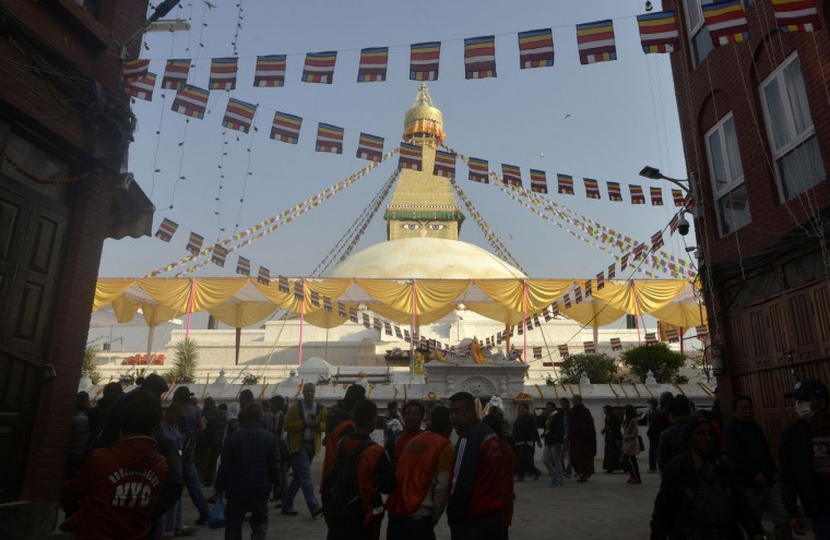 Buddhist devotees visit Boudhanath Stupa as it is reopened following renovation for earthquake damage on the outskirts of Kathmandu on November 22, 2016. Boudhanath Stupa was among hundreds of historic monuments damaged during the 7.8-magnitude quake that hit Nepal in April 2015 killing nearly 9,000 people. (Prakash Mathema/AFP/Getty Images)