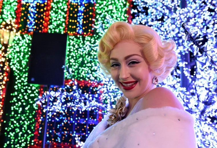 A Marilyn Monroe impersonator poses inside the Universal Journey during a media preview of Santa's All-Star Christmas at Universal Studios Singapore in Resorts World Sentosa on November 17, 2016. Singapore's Universal Studio broke the Guinness World Record for having the largest indoor display of lightbulbs with 824,961 bulbs in a festive light display separated into eight thematic zones.(ROSLAN RAHMAN/AFP/Getty Images)