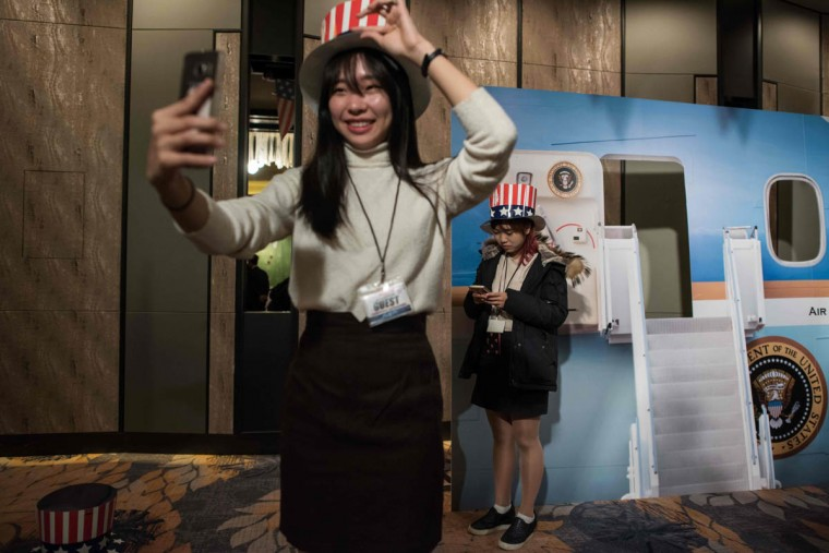 A woman poses for a selfie at an election event organised by the US embassy, at a hotel in Seoul on November 9, 2016. Donald Trump's stunning performance in the US presidential election triggered shock and angst in Asia, where observers fretted over the implications for everything from trade to human rights and climate change. / AFP PHOTO / Ed Jones
