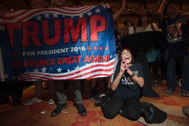 Supporter of Republican candidate Donald Trump, Robin Labani, 50, of Gilbert, Arizona cheers as election results come in during a viewing party at a hotel in downtown Phoenix, Arizona on November 8, 2016. Millions of Americans voted November 8th for their new leader in a historic election that will either elevate Democrat Hillary Clinton as their first woman president or hand power to maverick populist Donald Trump. / AFP PHOTO / Laura Segall