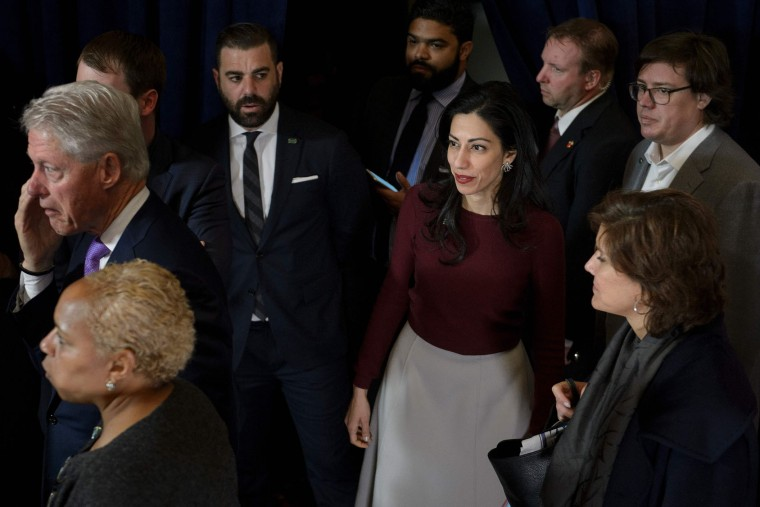 Former US President Clinton (L), top Clinton aide Huma Abedin (C) and others wait for former Democratic US Presidential candidate Hillary Clinton to finish greeting supporters at the New Yorker Hotel after her defeat in the presidential election November 9, 2016 in New York. (Brendan Smialowski/AFP/Getty Images)