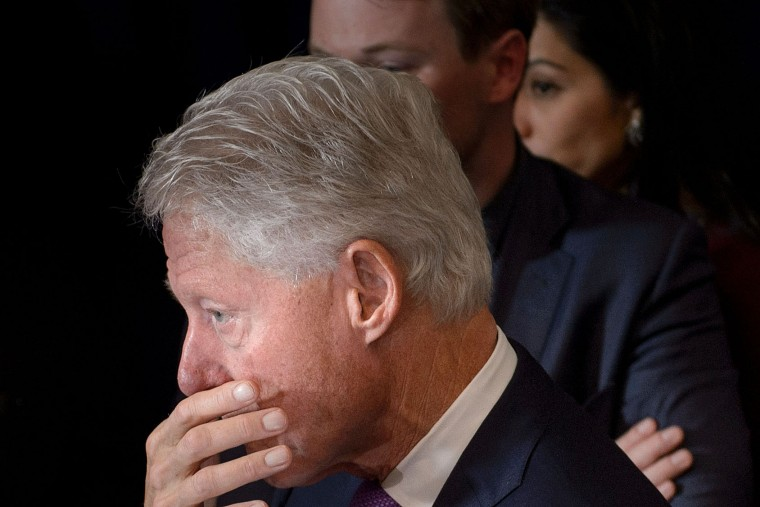 Former US President Clinton waits for his wife former Democratic US Presidential candidate Hillary Clinton after she spoke to the press at the New Yorker hotel after her defeat last night in the presidential election November 9, 2016 in New York. Former Democratic US Presidential candidate Hillary Clinton leaves with former US President Clinton after speaking at the New Yorker Hotel after her defeat in the presidential election November 9, 2016 in New York. (Brendan Smialowski/AFP/Getty Images)