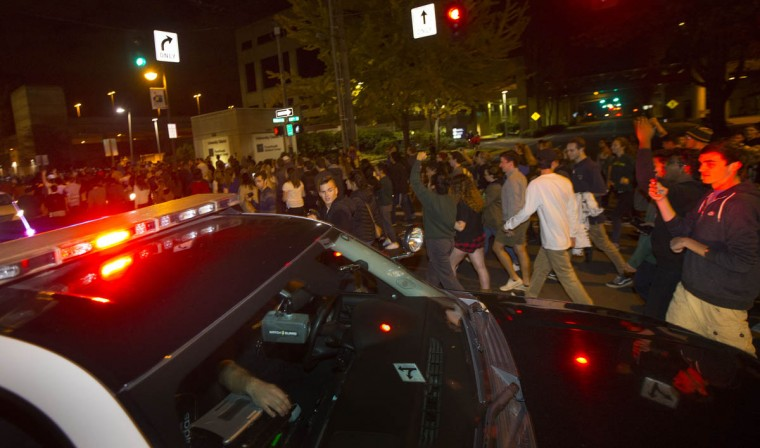 Police block traffic for a rally against President-elect Donald Trump as people march down a street east of the University of Oregon campus in Eugene, Ore., Wednesday, Nov. 9, 2016. (Chris Pietsch/The Register-Guard via AP)