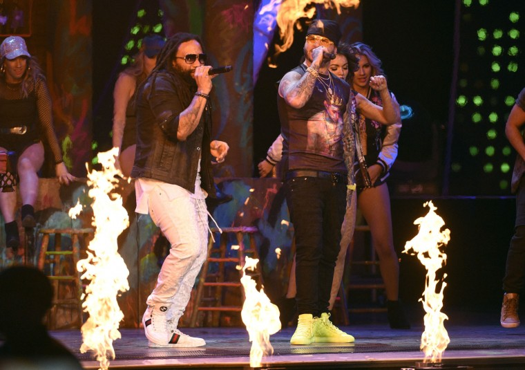 "Ky-Mani Marley, left, and Farruko perform ""Chillax"" at the 17th annual Latin Grammy Awards at the T-Mobile Arena on Thursday, Nov. 17, 2016, in Las Vegas. (Photo by Chris Pizzello/Invision/AP)"