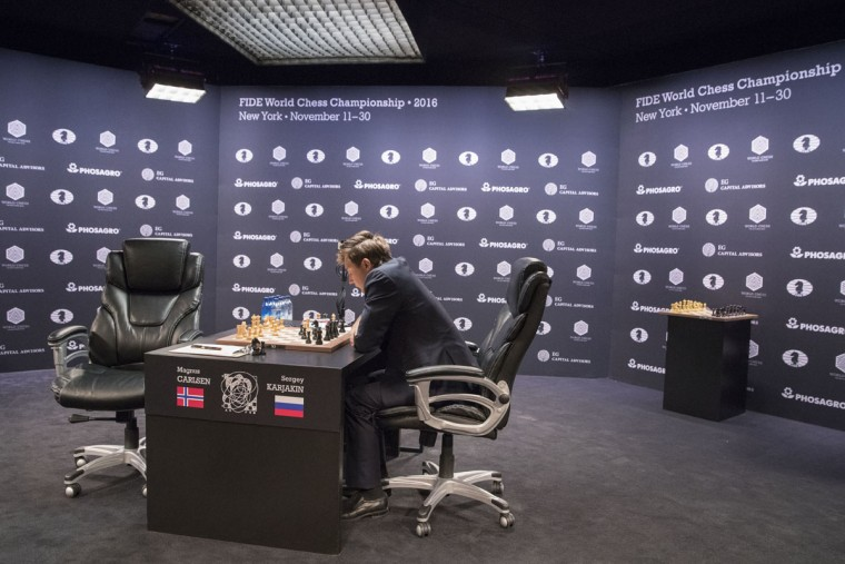 Sergey Karjakin, of Russia, studies the board during the first round of the World Chess Championship against champion Magnus Carlsen, not in photo, of Norway, Friday, Nov. 11, 2016, in New York. (AP Photo/Mary Altaffer)