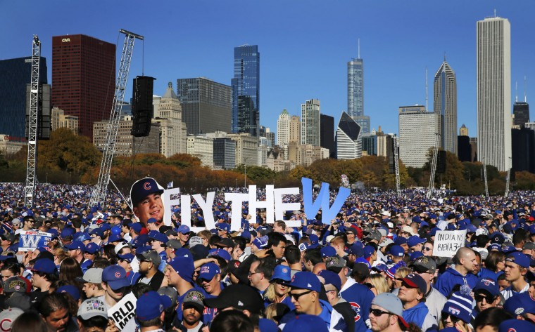 Chicago Cubs fans celebrate during a rally in Grant Park honoring the World Series baseball champions Friday, Nov. 4, 2016, in Chicago. (AP Photo/Charles Rex Arbogast)
