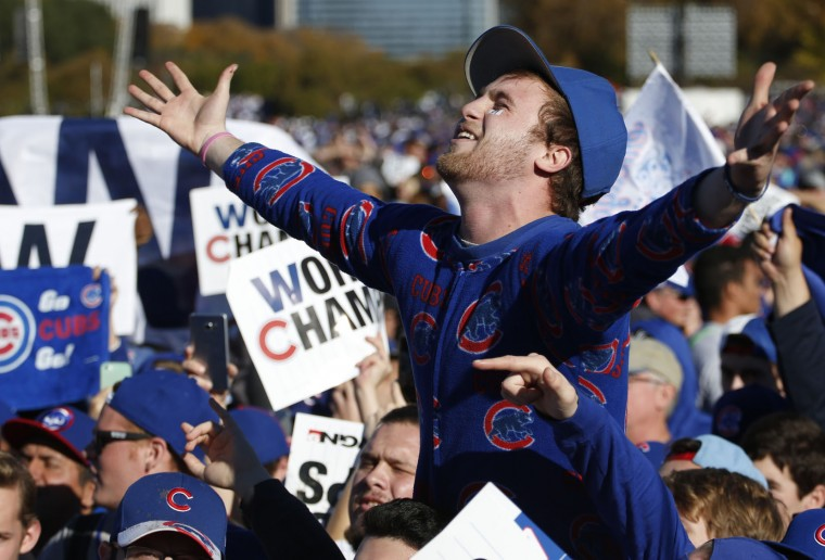 Chicago Cubs fans celebrate before a rally in Grant Park honoring the World Series baseball champions in Chicago, Friday, Nov. 4, 2016. (AP Photo/Nam Y. Huh)