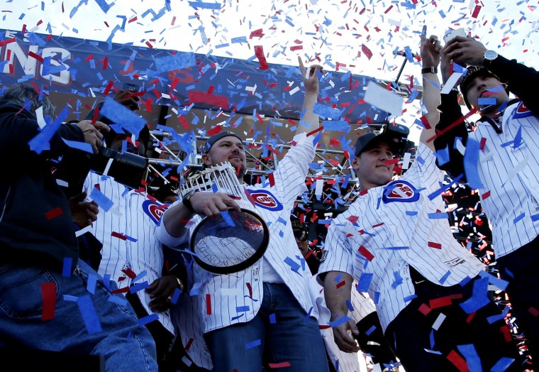 Chicago Cubs' Jon Lester holds the Commissioners Trophy as he celebrates with teammates during a celebration honoring the World Series champions at Grant Park in Chicago, Friday, Nov. 4, 2016. (AP Photo/Nam Y. Huh)