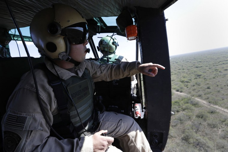 In this Tuesday, Nov. 15, 2016, photo, a U.S. Air and Marine Huey search for immigrants who entered the county illegally on a ranch near Edinburg, Texas. (AP Photo/Eric Gay)