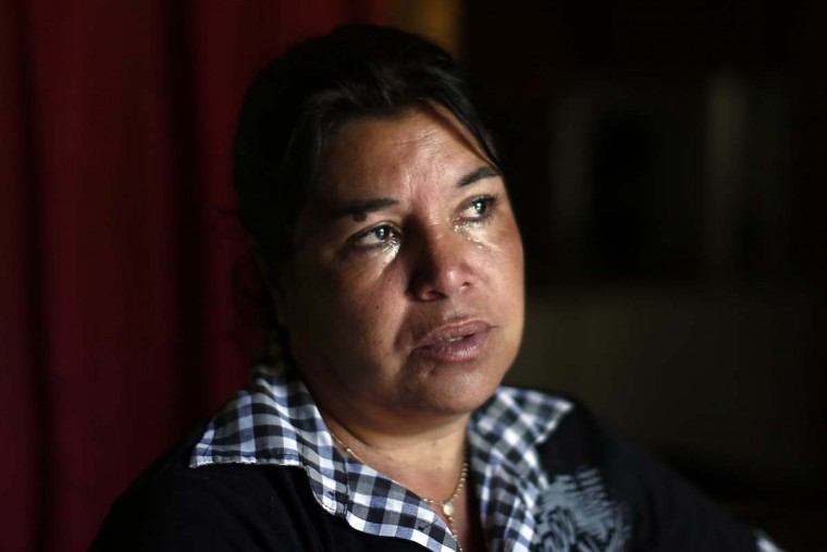 "In this Oct. 22, 2016 photo, Juana Poblete cries as she talks about her daughter, Lissette, who died under the care of the Chilean state, in Til Til, Chile. The former head of the National Service for Minors later said that Lisette died because she was ""conflictive."" But a police investigation has shown that the child's caretakers were partly responsible for her death and failed to administer the CPR that could have saved her life. (AP Photo/Luis Hidalgo)."
