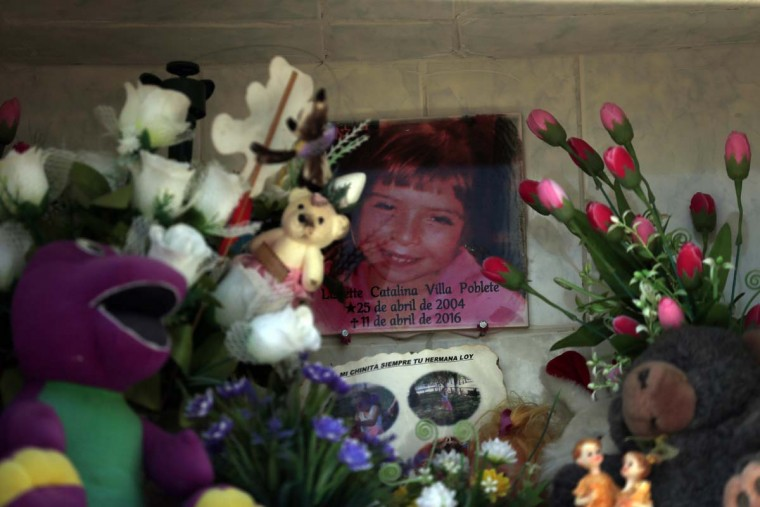 "In this Oct. 22, 2016 photo, the photo of Lissette decorates her tomb in Til Til, Chile. Lissette died under the care of the Chilean state, suffocating in her own vomit while a caretaker allegedly sat on her back while trying to contain the 11-year-old during what was described as ""a crisis of aggressiveness."" (AP Photo/Luis Hidalgo)"