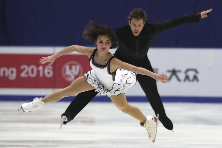 Liubov Ilyushechkina and Dylan Moscovitch of Canada compete in the Pairs Short Program during the Audi Cup of China ISU Grand Prix of Figure Skating 2016 held in Beijing's Capital Gymnasium on Friday, Nov. 18, 2016. (AP Photo/Ng Han Guan)