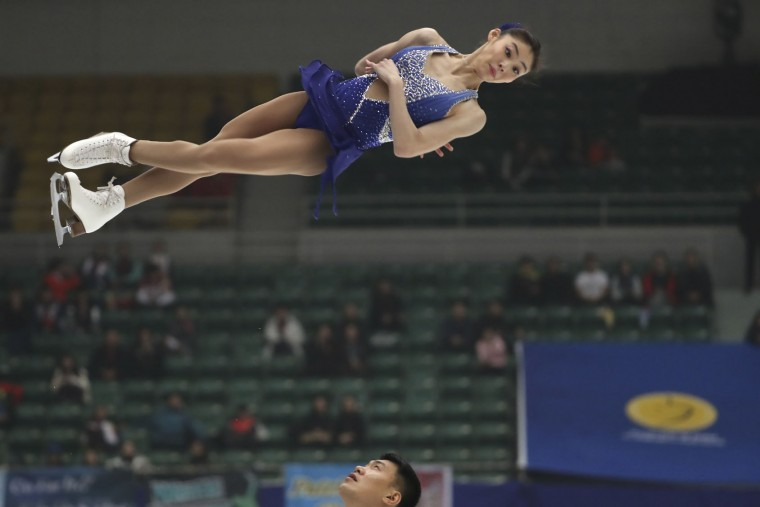 Yu Xiaoyu and Zhang Hao of China competes in the Pairs Short Program during the Audi Cup of China ISU Grand Prix of Figure Skating 2016 held in Beijing's Capital Gymnasium on Friday, Nov. 18, 2016. (AP Photo/Ng Han Guan)