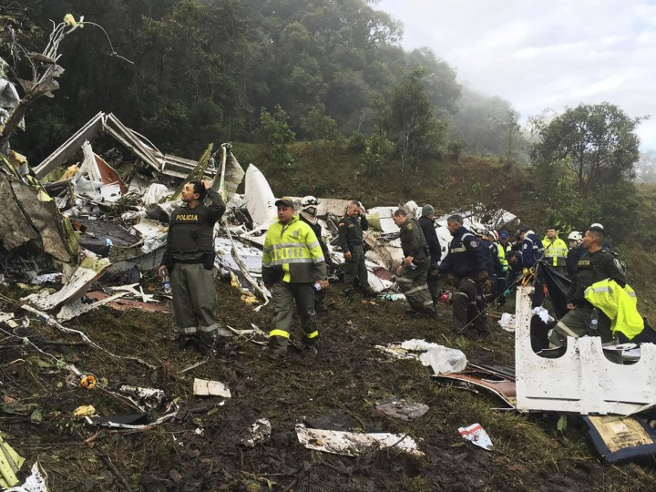 Rescue teams work at the site of a chartered airplane that crashed in La Union, a mountainous area outside Medellin, Colombia, Tuesday, Nov. 29, 2016. The plane was carrying the Brazilian first division soccer club Chapecoense team that was on it's way for a Copa Sudamericana final match against Colombia's Atletico Nacional. (Colombia National Police via AP)