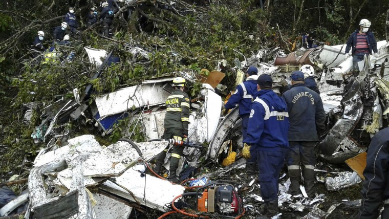 Rescue teams work at the wreckage site of a chartered airplane that crashed in La Union, a mountainous area outside Medellin, Colombia, Tuesday, Nov. 29, 2016. The plane was carrying the Brazilian first division soccer club Chapecoense team that was on it's way for a Copa Sudamericana final match against Colombia's Atletico Nacional. (Colombia National Police via AP)