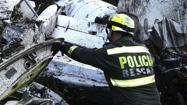 A rescue policeman works at the site of a chartered airplane crash in La Union, a mountainous area outside Medellin, Colombia, Tuesday, Nov. 29, 2016. The plane was carrying the Brazilian first division soccer club Chapecoense team that was on it's way for a Copa Sudamericana final match against Colombia's Atletico Nacional. (Colombia National Police via AP)