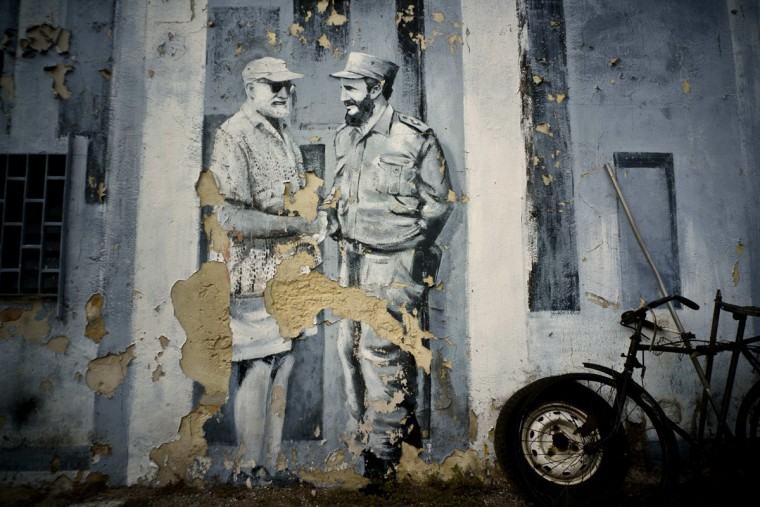 A mural featuring American author Ernest Hemingway, left, shaking hands with Fidel Castro decorates a wall in a parking lot in Havana, Cuba, Sunday, Nov. 27, 2016. Castro, who led a rebel army to improbable victory, embraced Soviet-style communism and defied the power of 10 U.S. presidents during his half century rule of Cuba, died at age 90 in Cuba late Friday. (AP Photo/Ramon Espinosa)