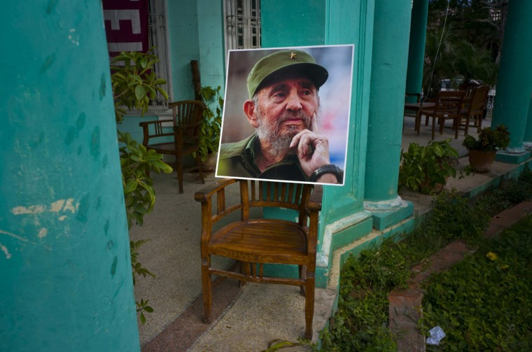 An image of the late Fidel Castro stands on a chair in a government building in Havana, Cuba, Sunday, Nov. 27, 2016. Cuba is observing nine days of mourning for the former president who ruled Cuba for half a century. (AP Photo/Ramon Espinosa)