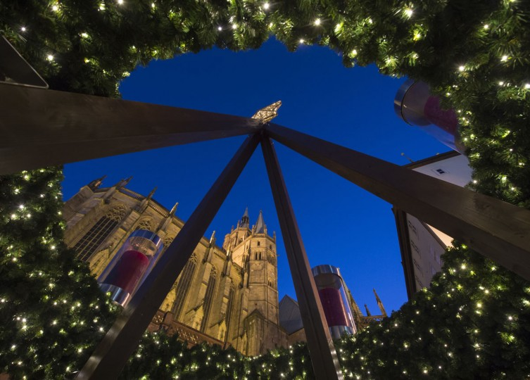 An Advent wreath with candles stands in front of the Mariendom (Cathedral of Mary) during the Christmas Fair in Erfurt, central Germany, Monday, Nov. 28, 2016. The Erfurt Christmas Market is one of the most beautiful Christmas Markets in the whole of Germany. The square is beautifully decorated with a huge, candle-lit Christmas tree and a large, hand-carved wooden creche. (AP Photo/Jens Meyer)