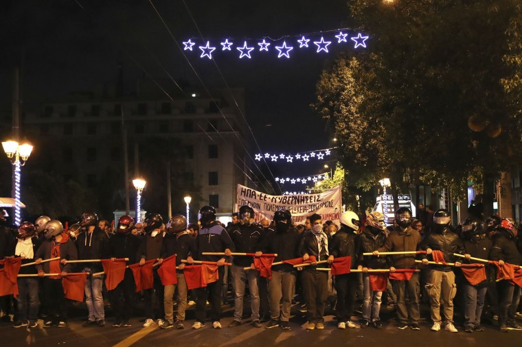 Leftist demonstrators march in protest against the visit of US President Barack Obama in Athens, Tuesday, Nov. 15, 2016. Greek police say about 3,000 anarchists, leftwing group supporters and students are marching through central Athens, to protest President Barack Obama's visit. (AP Photo/Yorgos Karahalis)