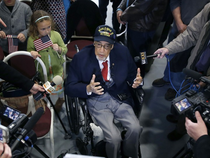 WWII veteran Wallace Higgins, 91, a recipient of the Congressional Gold Medal appears at the National Warplane Museum in Geneseo, N.Y., on Veterans Day, Friday, Nov. 11, 2016. (Carlos Ortiz/Democrat & Chronicle via AP)