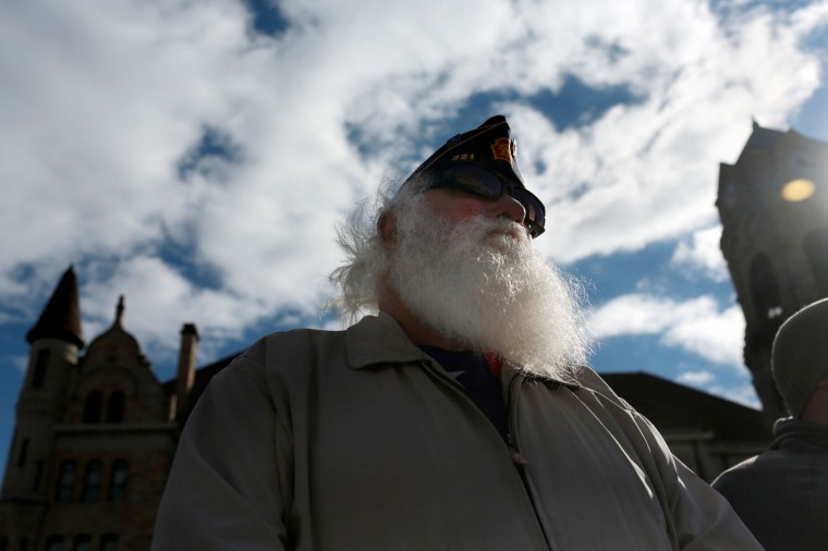 Army veteran Lewis Williamson, of Scranton, listens to a speech during the Koch Conley American Legion Post 121 annual Veterans Day program on Lackawanna County Courthouse Square in Scranton, Pa., on Friday, Nov. 11, 2016. (Jake Danna Stevens/The Times & Tribune via AP)