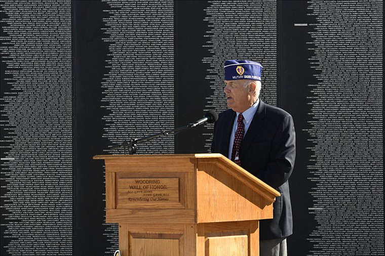 Former United States Marine Corps Capt. Doug Franz addresses an audience during the Veterans Day Remembrance ceremony at the Vietnam Memorial Wall at the Woodring Wall of Honor and Veterans Park in Enid, Okla., friday Nov. 11, 2016. (Billy Hefton/The Enid News & Eagle via AP)