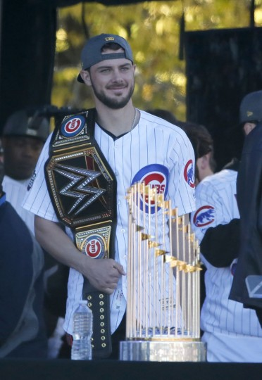 Chicago Cubs' Chris Bryant is introduced to the crowd during a rally in Grant Park honoring the World Series baseball champions Friday, Nov. 4, 2016, in Chicago. (AP Photo/Charles Rex Arbogast)