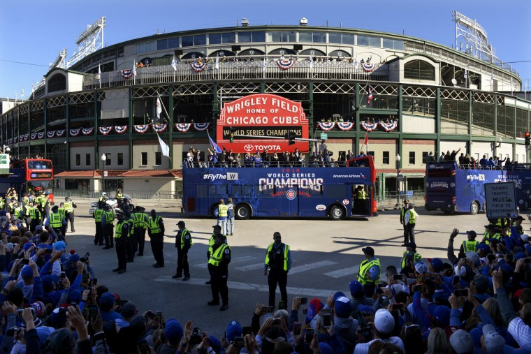 A parade honoring the World Series champion Chicago Cubs passes Wrigley Field Friday, Nov. 4, 2016, in Chicago. (AP Photo/Paul Beaty)