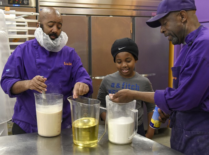 "Three generations of James Hamlins prepare ingredients for their famous ""Poppay's"" dinner rolls. Left to right: James Hamlin, his son James ""L.J."" Hamiln, and James W. Hamlin, right, who is the owner of The Avenue Bakery. (Barbara Haddock Taylor/Baltimore Sun)"