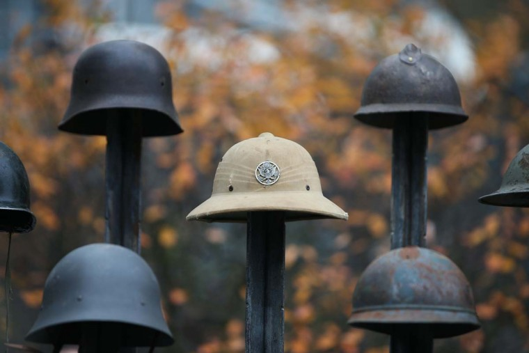 "An art installation called 'Lost Soldiers' made with helmets is pictured as part of a Remembrance Art Trail in association with the Royal British Legion created by artist Mark Humphrey at Canary Wharf in east London on October 31, 2016. The Remembrance Art Trail consists of seven works made from military materials and salvage created by Mark Humphrey in association with the Royal British Legion and installed at Canary Wharf in the run up to Remembrance Sunday. Remebrance Sunday is a commemoration of the contribution of British and Commonwealth servicepeople in the two World Wars and later conflicts in the run up to which The Royal British Legion distributes remembrance poppys in return for donations to their ""Poppy Appeal"", which supports all current and former British military personnel. (DANIEL LEAL-OLIVAS/AFP/Getty Images)"