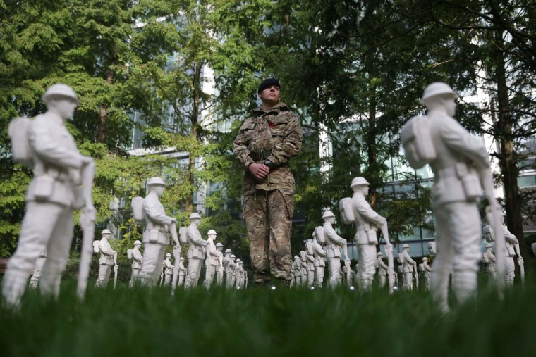"British Royal Engineers Sapper Liam Robertson poses for a picture in the middle of an art installation called 'Lost Armies' created by artist Mark Humphrey part of a Remembrance Art Trail in association with the Royal British Legion ahead of Remebrance Sunday at Canary Wharf in east London on October 31, 2016. The Remembrance Art Trail consists of seven works created by Mark Humphrey in association with the Royal British Legion and installed at Canary Wharf in the run up to Remembrance Sunday. Remebrance Sunday is a commemoration of the contribution of British and Commonwealth servicepeople in the two World Wars and later conflicts in the run up to which The Royal British Legion distributes remembrance poppys in return for donations to their ""Poppy Appeal"", which supports all current and former British military personnel. (DANIEL LEAL-OLIVAS/AFP/Getty Images)"
