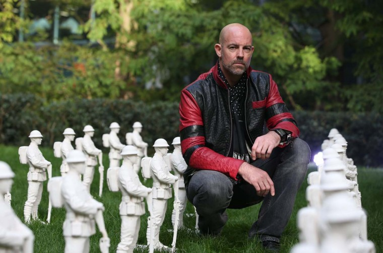 """Artist Mark Humphrey poses for a picture during a photo call for the Remembrance Art Trail in association with the Royal British Legion at Canary Wharf in east London on October 31, 2016. The Remembrance Art Trail consists of seven works made from military materials and salvage created by Mark Humphrey in association with the Royal British Legion and installed at Canary Wharf in the run up to Remembrance Sunday. Remebrance Sunday is a commemoration of the contribution of British and Commonwealth servicepeople in the two World Wars and later conflicts in the run up to which The Royal British Legion distributes remembrance poppys in return for donations to their """"Poppy Appeal"""", which supports all current and former British military personnel. (DANIEL LEAL-OLIVAS/AFP/Getty Images)"""