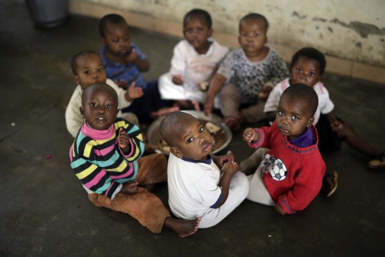 In this photo taken on Saturday, June 18, 2016, orphans eat their lunch at the Don Bosco center in Goma, Democratic Republic of Congo. More than four million children have lost at least one parent in Congo over the past two decades. (AP Photo/Jerome Delay)