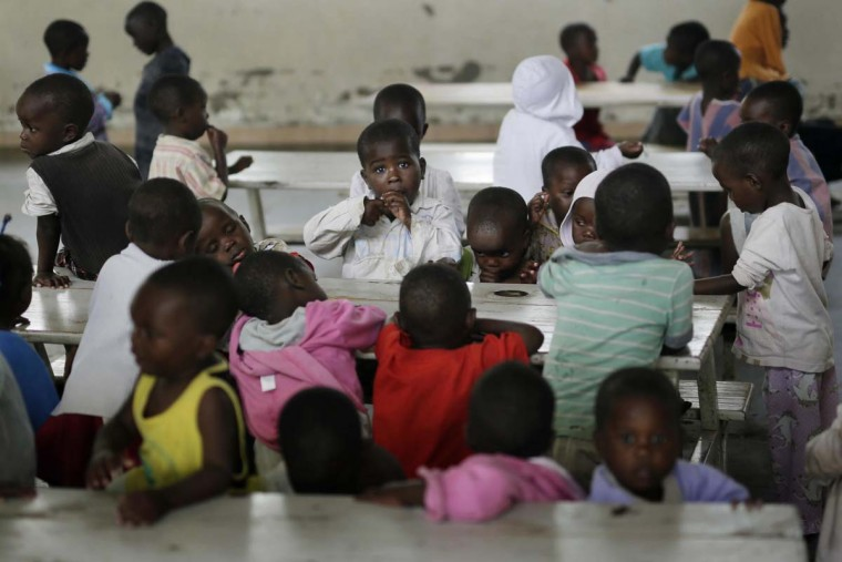 In this photo taken on Saturday, June 18, 2016 ,orphans eat their lunch at the Don Bosco center in Goma, Democratic Republic of Congo. More than four million children have lost at least one parent in Congo over the past two decades. (AP Photo/Jerome Delay)