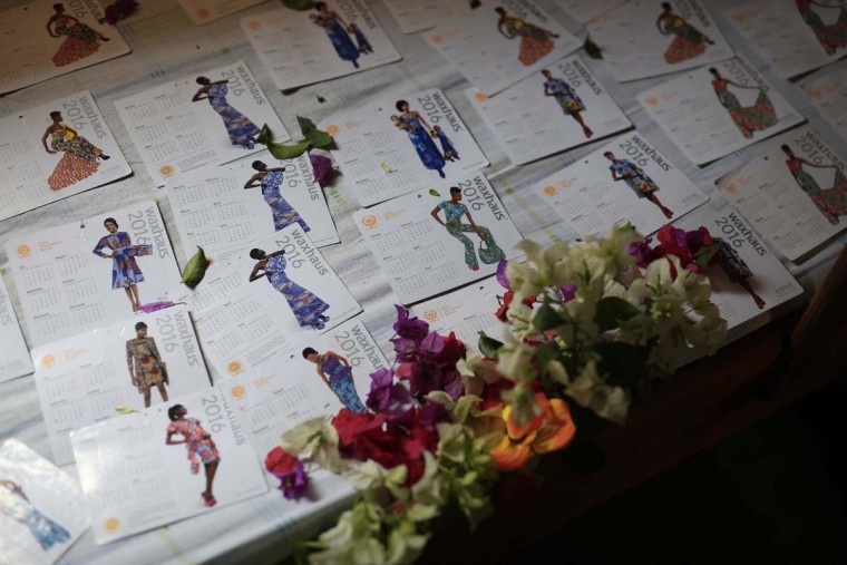 In this photo taken on Sunday, June 19, 2016, the bed of Jeannette Umutesi, 16, is seen covered by fashion calendars, at the En Avant Les Enfants INUKA center in Goma, Democratic Republic of Congo. Born only a few years after Rwanda's 1994 genocide spilled into Congo and rebellions started forming, Jeannette has known only Congo's and her father's violence, displacement and death. (AP Photo/Jerome Delay)