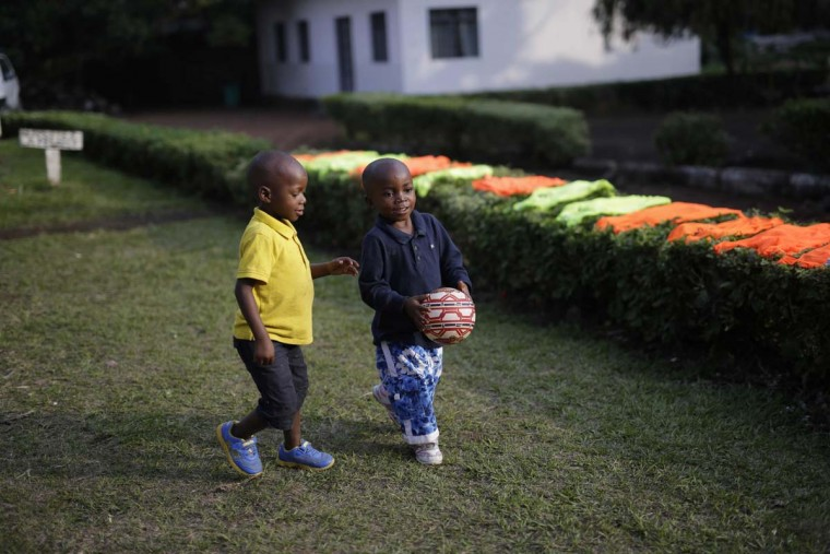 In this photo taken on Sunday, June 19, 2016, five-year-old Alpha Meleki, right, plays in the yard at the En Avant Les Enfants INUKA center in Goma, Democratic Republic of Congo. Melee survived an attack from ADF rebels on his village that left over 20 dead including his parents in Beni in January 2016. Rescuers found Meleki in a pile of bodies with a bullet wound to his belly. (AP Photo/Jerome Delay)