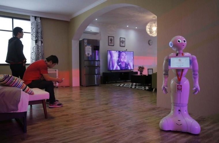 "A robot is displayed for a smart home at an exhibition during the ""Singles' Day"" global online shopping festival in Shenzhen, southern China's Guangdong province Friday, Nov. 11, 2016. In a bright spot for China's cooling economy, online shoppers spent billions of dollars Friday on ""Singles Day,"" a quirky holiday that has grown into the world's busiest day for e-commerce. (AP Photo/Kin Cheung)"