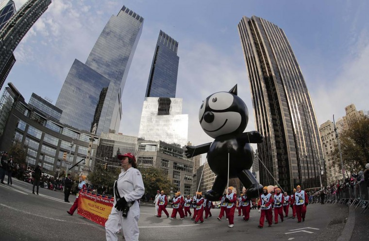 The Felix the Cat balloon is guided through Columbus Circle during the Macy's Thanksgiving Day parade, Thursday, Nov. 24, 2016, in New York. The balloon was one of the original balloons to appear in the first Macy's Parade. (AP Photo/Julie Jacobson)
