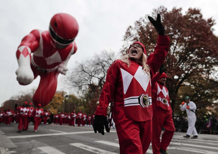 A balloon operator waves to spectators while guiding the Red Ranger balloon along West Central Park during the Macy's Thanksgiving Day parade, Thursday, Nov. 24, 2016, in New York. (AP Photo/Julie Jacobson)