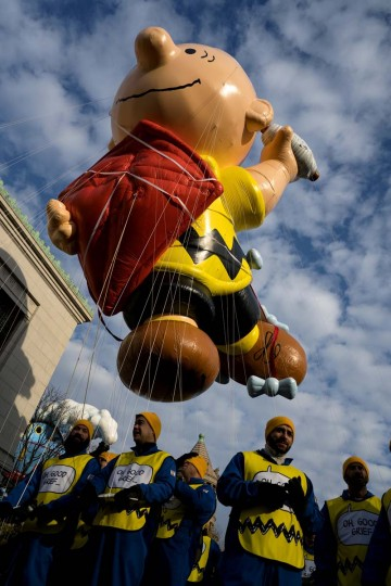 The Charlie Brown balloon floats over Central Park West during the Macy's Thanksgiving Day Parade in New York Thursday, Nov. 24, 2016. (AP Photo/Craig Ruttle)