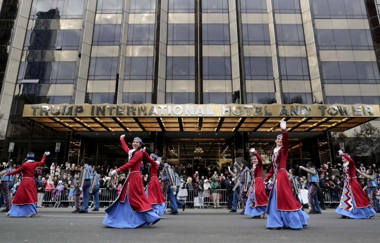 Sayat Nova Dance Company dancers wave to spectators as they walk past the Trump International Hotel and Tower during the Macy's Thanksgiving Day parade, Thursday, Nov. 24, 2016, in New York. (AP Photo/Julie Jacobson)