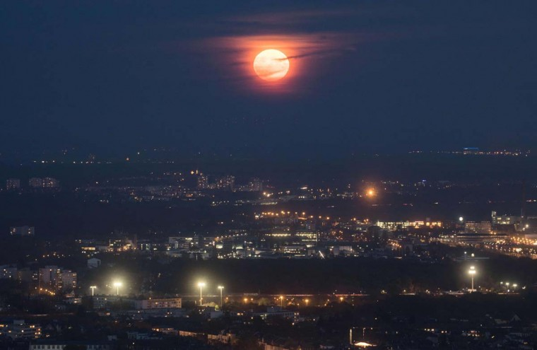"The so-called ""Supermoon"" is seen from the Maintower in Frankfurt am Main, Gertmany, on November 14, 2016. The unusually big and bright moon appeared at its most impressive as night fell over Asia, but astronomy enthusiasts will be able to see Earth's satellite loom large anywhere in the world shortly after sunset. (FRANK RUMPENHORST/AFP/Getty Images)"