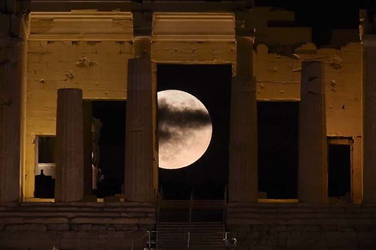 "The 'Supermoon' rises behind the Propylaea above the Ancient Acropolis hill in Athens on November 14, 2016. The moon will be the closest to Earth since 1948 at a distance of 356,509 kilometres (221,524 miles), creating what NASA described as ""an extra-supermoon"". (ARIS MESSINIS/AFP/Getty Images)"