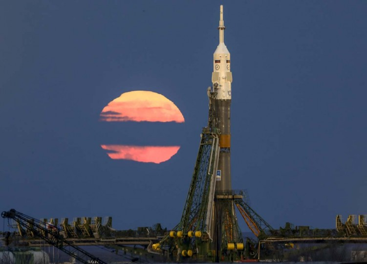 The supermoon backdrops Russia's Soyuz-FG booster rocket with the Soyuz MS-03 space ship that will carry new crew to the International Space Station (ISS) installed at the launch pad at the Russian leased Baikonur cosmodrome, Kazakhstan, Monday, Nov. 14, 2016. (AP Photo/Dmitri Lovetsky)
