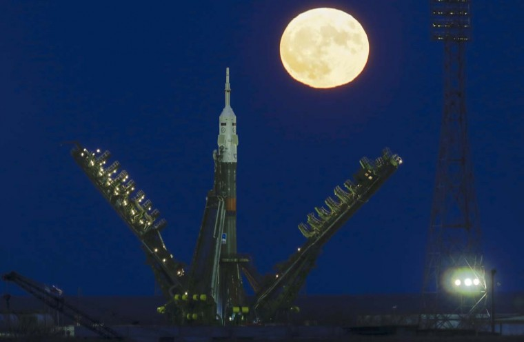 The supermoon rises over Russia's Soyuz-FG booster rocket with the Soyuz MS-03 space ship that will carry new crew to the International Space Station (ISS) installed at the launch pad at the Russian leased Baikonur cosmodrome, Kazakhstan, Monday, Nov. 14, 2016. Start of the new Soyuz mission to the International Space Station (ISS) is scheduled on early Friday, Nov. 18 local time. The Russian rocket will carry French astronaut Thomas Pesquet, Russian cosmonaut Oleg Novitsky and U.S. astronaut Peggy Annette Whitson. (AP Photo/Dmitri Lovetsky)