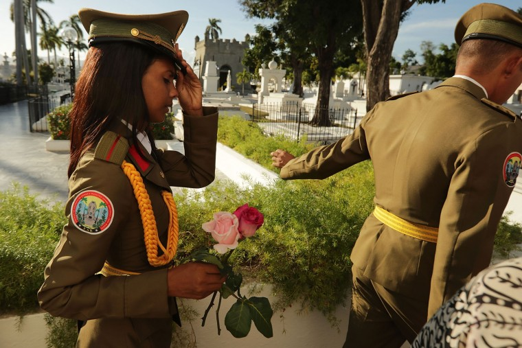 Military guards carry flowers through the Cementerio Santa Ifigenia where the remains of former Cuban President Fidel Castro were entombed December 4, 2016 in Santiago de Cuba, Cuba. The tomb stands to the side of a memorial to the rebel soldiers killed in an attack that Castro led on Santiago's Moncada barracks on July 26, 1953, and in front of the mausoleum of Cuban national hero Jose Marti. (Photo by Chip Somodevilla/Getty Images)