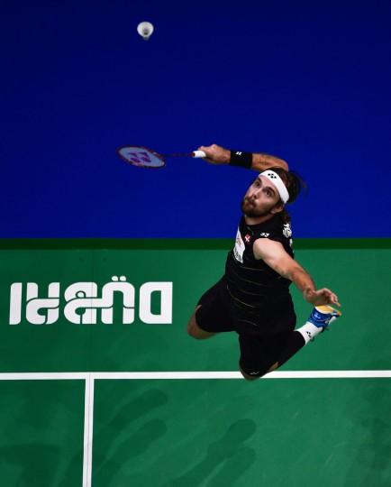 Jan Ostergaard Jorgensen of Denmark plays a shot against Hu Yun of Hong Kong during their men's singles badmindton match during the Dubai World Superseries Finals badminton tournament at the Hamdan Sports Complex in Dubai on December 14, 2016. (Stringer/AFP/Getty Images)