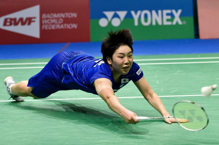 Akane Yamaguchi of Japan hits a return during her women's singles badminton match against Pusarla V Sindhu of India at the Dubai World Superseries Finals badminton tournament at the Hamdan Sports Complex in Dubai on December 14, 2016. (Stringer/AFP/Getty Images)