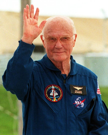 FILE - This file photo taken on October 8, 1998 shows US Senator and astronaut John Glenn waving to the media during a shuttle crew interview session at Kennedy Space Center. Glenn, who made history twice as the first American to orbit the Earth and the first senior citizen to venture into space, has died at the age of 95, the Ohio State University's John Glenn College of Public Affairs said on December 8, 2016. (Bruce Weaver/AFP/Getty Images)